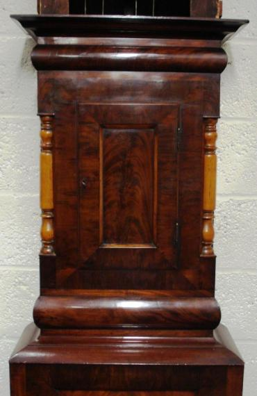 Imposing flame mahogany cased, grandfather longcase clock. Swan neck hood with contrasting light coloured turned wood pillars and further matching turned pillar case decoration. Painted face with subsidiary seconds and date display dials. Bell striking, 8 day movement circa 1850, signed to the dial R.Easby, Durham.