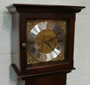 Modern mahogany finished, 8 day, spring driven Westminster chiming grandfather longcase clock by Metamec of Dereham. Pendulum movement with decorative brass face, silvered chapter ring, brass spandrels, black hands and black roman hour markers.