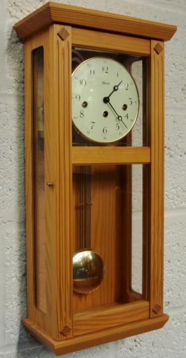 "Brand new pine cased 8 day spring driven Westminster chiming pendulum wall clock by Franz Hermle & Son. Case height - 22""."