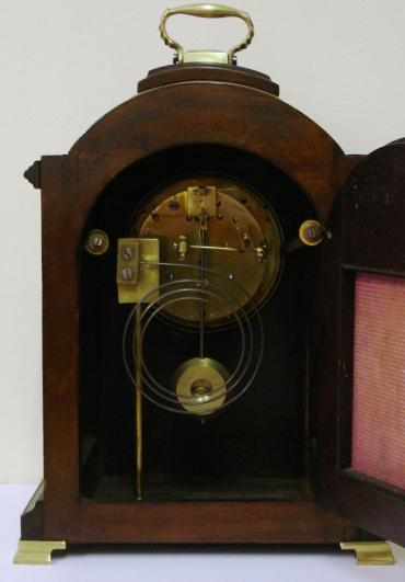 French 8 day gong striking spring driven pendulum minature style bracket clock circa 1900 by Japy Freres. Stained oak and mahogany case with brass inlay and gilt brass bracket feet and handle. Brass bezel with convex chamfered glass over white enamel dial with black arabic hours and outer minutes track, and black steel hands. Brass drum movement stamped 'Japy Freres' and 'Medaille d'Honneur' and numbered #1600