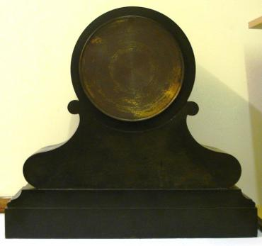 Heavy 8 day scrolling black marble cased mantel clock with malachite inlay and carved and gilded floral motif decoration circa 1890. Circular gilt bezel with flat chamfered glass over a black dial with gilt roman hours and gilt hands, together with the Brocot visible escapement below 12 o'clock and slow/fast adjuster at the dial top. French brass spring driven pendulum regulated movement striking on a bell, maker unknown, but stamped on the back plate #274.