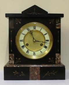 german 8 day gong striking mantel clock in slate and marble case by Junghans