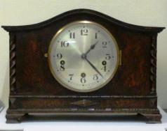 dark stained oak cased 8 day westminster chime mantel clock with french lever escapement