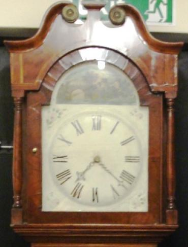 Clock for sale for restoration. English 30 hour oak and mahogany cased bell striking long case grandfather clock. Scrolling swan neck topped case with turned side columns, original glass over a aged painted dial, black roman hours and brass hands. Lacks pendulum and weight.