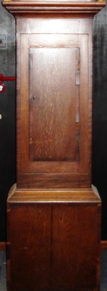 Clock for sale for restoration:- English 30 hour oak and mahogany cased bell striking longcase grandfather clock. Scrolling swan neck topped case with fluted side columns, crossbanded door with original glass over painted face with floral decoration. Black roman hours and brass hands. Lacks weight, pendulum and original backboard.