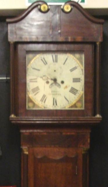 Clock for sale for restoration:- English 8 day oak and mahogany cased bell striking longcase grandfather clock by W. Evans of Shrewsbury circa 1820. Scrolling swan neck pediment with cross banding and shell motif inlay together with  fluted brass capped side columns. Original glass over painted and gilded dial with floral decoration and black roman hours, date aperture and seconds dial. Lacks minute and seconds hands, weights and pendulum.