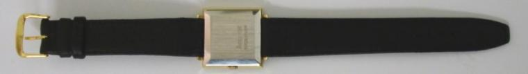 Accurist Shockmaster manual wind wrist watch in a square gold plated case with stainless steel back, on a black leather strap with gilt buckle. Brushed gilt dial with gilt baton hour markers and matching hands, date display at 3 o/c. Signed swiss Peseux calibre 7046 21 jewel incabloc movement.