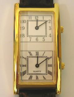 modern quartz dual time display wrist watch in gold plated case with stainless steel back