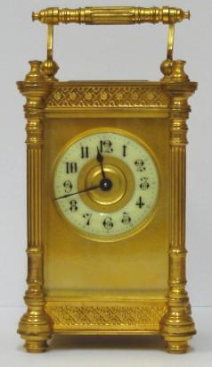 french 8 day carriage clock time piece brass and glass masked ivorine dial gothic hours black hands