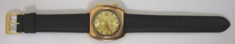 Swiss Emperor alarm wrist watch in a gold plated case with stainless steel back and secondary dust cover, on a black leather strap with gilt buckle. Gilt dial with black minute track and baton hour markers, gilt luminous insert hands and sweep seconds. Red alarm pointer hand and date display at 3 o/c. Swiss 17 jewel incabloc manual wind movement.
