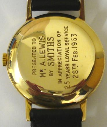 Smiths Everest manual wind presentation wrist watch in a 9ct gold case on a black leather strap with gilt buckle. Champagne dial with gilt arabic and baton hour markers and matching gilt hands with red tipped sweep seconds. Smiths 19 jewel calibre 0104 movement with snap on case back hallmarked for London 1961 and inscribed to Mr A LEWIS for 25 years with Smiths - February 1963 and with original fitted box.