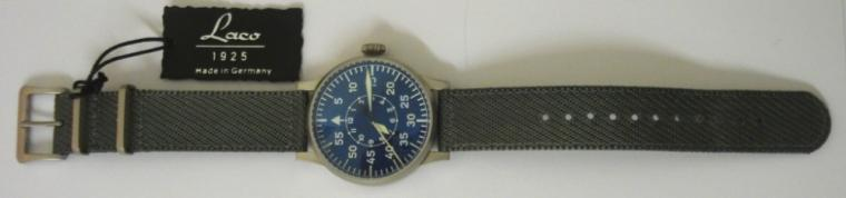 New German Laco Flieger Leipzig FL23883 manual wind wrist watch in an All Stainless Steel case with grey nylon strap with steel buckle. Sapphire crystal over a radiant blue dial with luminous arabic outer minute track and inner hours ring. Blue edged hands with luminous inserts and sweep seconds hand. Large button crown and engraved back over a Swiss ETA 2801.2 movement, case water resistant to 5 ATM. Brand new watch with all box and paperwork and 2 year manufacturers guarantee.