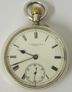 English silver cased open face pocket watch by W.Bryer & Sons of London, hallmarked for 1908. White enamel dial with black roman hours, blued steel hands and subsidiary seconds dial. Top wind and rocking bar time change three quarter plate jewelled lever movement with split bi-metallic balance and over coil hair spring and numbered #22136.