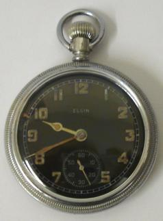 Elgin National Watch Co. WW2 military pocket watch. Black enamel dial with old luminous arabic hours, matching hands and subsidiary seconds dial at 6 o/c. Base metal case with screw on front and back with 9 jewel jewelled lever movement numbered #41230358 and dating from 1943. The case back is worn but bears the broad arrow mark and is numbered A97134.