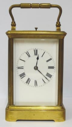 French gilt brass and 5 glass, 8 day strike / repeat carriage clock circa 1880 by Henri Jacot. Corniche case with chamfered glass panels throughout, white enamel dial with black Roman hours and minute track and blued steel hands. Back plate with Jacot arrow and numbered #6702 below a contemporary silvered jewelled lever escapement. 'Hidden' oval Henri Jacot stamp applied internally to the back of the dial plate.