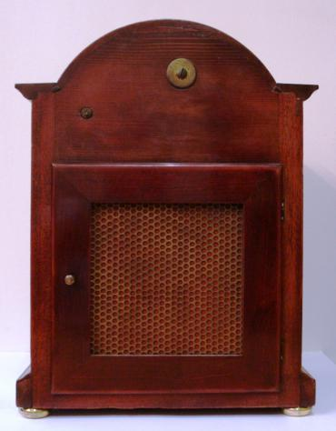 Mahogany case with decorative 'barley twist' columns. Silvered dial with chime/silent function and fine regulating time adjuster, surrounded by brass bezel with bevelled glass. 8 day Westminster chiming movement c1900.