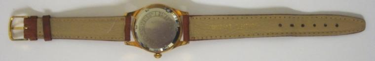 Swiss Curtis automatic wrist watch in a gold plated case with stainless steel back, on a tan leather strap with gilt buckle. Brushed silvered dial with gilt dart and 12, 3, 6 and 9 hour markers with matching gilt luminous insert hands and sweep seconds. Swiss made Felsa 1560 25 jewel incabloc movement with screw down case back.