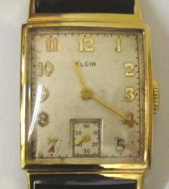 American Elgin manual wind wrist watch in a gold plated case with base metal back on a brown leather strap with gilt buckle. Silvered dial with gilt arabic hour markers and matching hands and subsidiary seconds dial. Signed 15 jewel movement numbered C667671 with case back numbered #7412317.