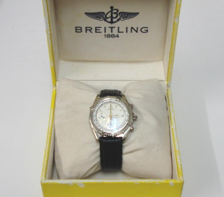 Breitling Automatic Chronograph in a stainless steel case on an original black leather strap. Sapphire crystal over a white dial with gilt and luminous baton hour markers and matching hands with a subsidiary seconds dial and date display at 3 o/c. 12 hour chronograph time recording via the sweep seconds hand and subsidiary hours and minutes dials. Screw down crown and case back with signed 25 jewel calibre 7750 Valjoux movement complete with all original paperwork and boxes.