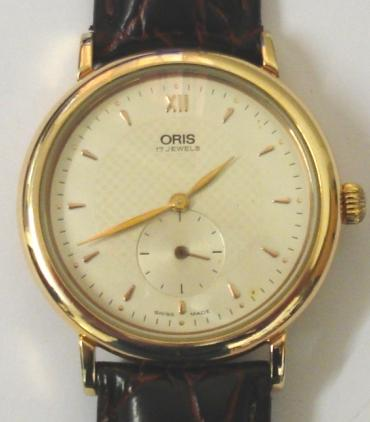 Oris 7423B Classic manual wind wrist watch in a gold plated case with stainless steel back on a dark red leather strap with gilt buckle. Silvered textured dial with gilt XII and dart hour markers with matching hands and subsidiary seconds dial at 6 o/c. Swiss made Oris SA 17 jewel incabloc movement with case water resistant to 30 metres.