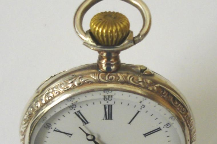 Ornate silver cased pocket watch with top wind and rocking bar time change. White enamel dial with black minute track and Roman hours with blued steel hands and subsidiary seconds dial. Swiss remontoir cylinder 6 jewel movement in a highly decorated case stamped 0.800 with ecclesiastical scene on outer case and numbered #587-17.
