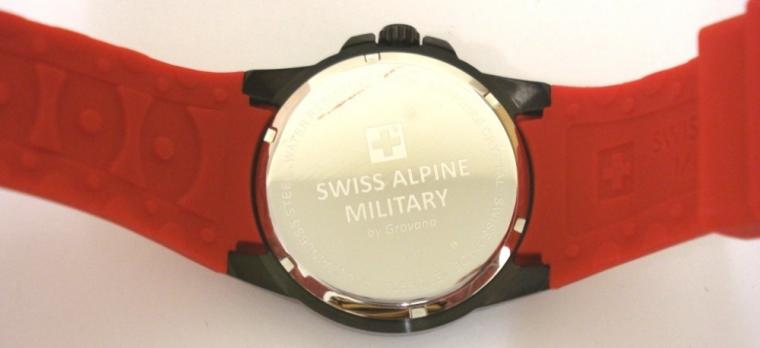 Brand new Swiss Alpine Military quartz wrist watch by Grovana in an all stainless steel black case with red rubber strap. Sapphire crystal over a black textured dial with luminous insert polished silver hours and matching hands, red seconds hand and date display at 3 o/c. Brand new model 7058.1LE watch number 1876 with screw down back water resistant to 100 metres complete with box, all paperwork and 2 year manufacturer's guarantee.
