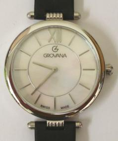 Brand new mid-size quartz wrist watch by Grovana in an all stainless steel case with black leather strap and silver buckle. Sapphire crystal over a mother of pearl dial with polished silver hours and matching hands. Brand new model 4450.1CK watch number 1533 water resistant to 50 metres complete with box, all paperwork and 2 year manufacturer's guarantee.