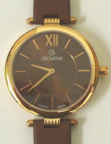 Brand new mid-size quartz wrist watch by Grovana in a gold plated case with stainless steel back and brown leather strap with gilt buckle. Sapphire crystal over a brown sunburst dial with polished gilt hours and matching hands. Brand new model 4450.1CK watch number 1566 water resistant to 50 metres complete with box, all paperwork and 2 year manufacturer's guarantee.
