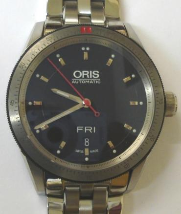 Oris 7662 Artex automatic wrist watch in an all stainless steel case with integral bracelet. Sapphire crystal over a black dial with polished silver hour markers and matching luminous insert hands, red sweep seconds and day / date display at 6 o/c. Oris High Mech 733 26 jewel automatic incabloc movement with screw down crown and screw on case back numbered 34-03097, water resistant to 100m.