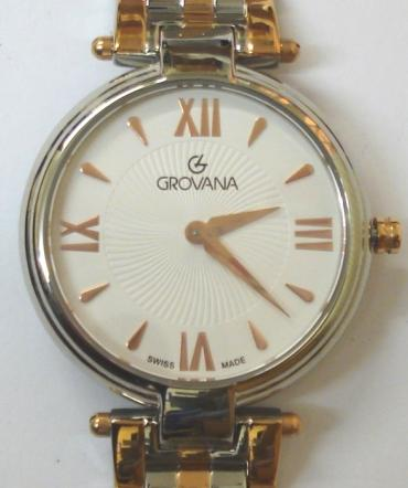 Brand new mid-size quartz wrist watch by Grovana in an all stainless steel case with integral two colour bracelet. Sapphire crystal over a white textured dial with polished gilt hours and matching hands. Brand new model 4576.1LE watch number 1152 water resistant to 30 metres complete with box, all paperwork and manufacturer's guarantee.