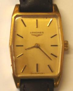 Ladies Longines wrist watch with manual wind 17 jewel movement circa 1960, housed in gold plated case with stainless steel back and brown leather strap. Gold coloured dial with gilt baton hour markers and matching hands. Case back internally numbered 817 10652 with signed Longines L3214 movement numbered 53335527.
