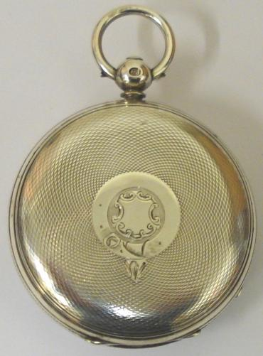 English jewelled lever silver cased key wound fusee pocket watch with London hallmark for 1865. White enamel dial with black Roman hours and blued steel hands with subsidiary seconds dial. Floral engraved cock piece with back plate numbered #3505 and gem set end stone, maker unknown.