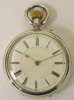 English silver cased open face pocket watch maker unknown, hallmarked for Chester c1897. White enamel dial with black Roman hours and gilt hour and minute hands. Top wind and rocking bar time change movement numbered #16695 with decorated cock piece and jewel end stone.