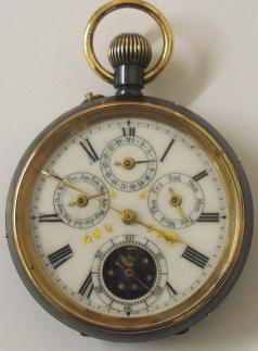 Swiss Full Calendar pocket watch in a blued steel case with top wind and rocking bar time change c1890. White enamel dial showing slight defects, black Roman hours with gilt hands and subsidiary seconds dial. Additional subsidiary dials displaying Day, Date and Month with Moon Phase indicator within the seconds dial. Swiss jewelled lever split bar movement with bi-metallic balance and numbered 11,170 and 9835.