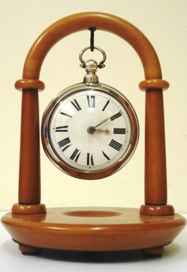 Modern wooden pocket watch stand by the 'Rapport' company. Available in both light and dark brown and black.