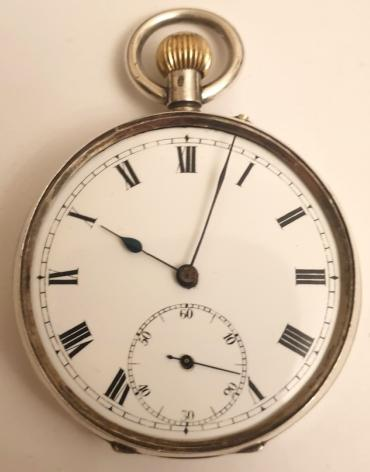 Swiss silver cased pocket watch, maker unknown. Top wind and rocking bar time change with white enamel dial and black Roman hours with black steel hands and subsidiary seconds dial. Unsigned Swiss 3/4 plate movement with cylinder escapement and case back bearing a London import hallmark for circa 1912 and numbered #69986.