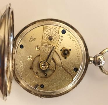 Swiss silver cased pocket watch made by the Swiss Watch Co. in an English case bearing a Birmingham hallmark for circa 1891. Key wind and time change with white enamel dial and black Roman hours with gilt hands and subsidiary seconds dial. Signed Swiss jewelled lever escapement with going barrel movement numbered #271648, the case back stamped 'LJ' and numbered #1811.