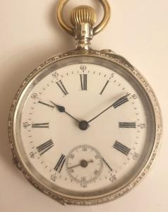 Swiss silver cased pocket watch late C19th, maker unknown. Top wind and rocking bar time change with white enamel dial and black Roman hours with outer Arabic minute track and blued steel hands with a subsidiary seconds dial at 6 o/c. The well engraved silver case stamped 0.800 together with the Swiss 1882-1934 proof mark and numbered #41689 together with an inscription for 'J. Emmenegger'. Undecorated 6 jewel split bar movement with cylinder escapement, a jewelled balance and a remontoire power source.
