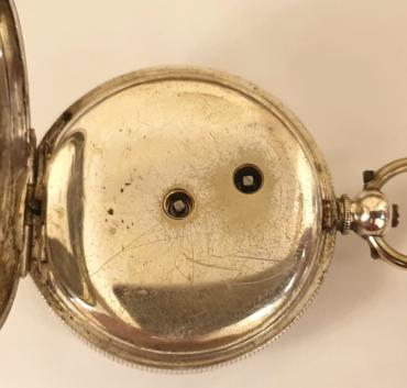 Swiss unsigned silver cased small pocket / fob watch late C19th / early C20th. Key wind and time change with floral decorated white enamel dial and black Roman hours with gilt hands, the well engraved silver case stamped 800M together with a Swiss 1882-1934 proof mark and numbered #60622 with initial 'L'. Undecorated split bar movement with cylinder escapement and jewelled balance.