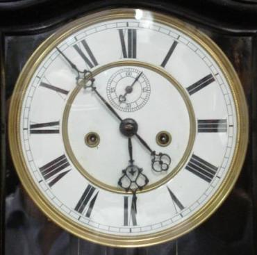 Ebonised cased 8 day, key wound, weight driven, gong striking, Vienna style Regulator movement, dating from c1880. Casework incorporates turned wood finials and full length glazed door. White enamel dial with black roman hours and ornate steel hands and subsidiary seconds dial.