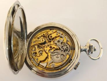 Extremely rare Swiss silver cased full hunter triple complication pocket watch probably made by Le Phare in Le Loc in the early 1900s. White enamel dial with gilt hands and date pointer at 12, day and month apertures at 9 and 3, small seconds at 6 and moon phase, with black Arabic hours and blue 24hr markers. Swiss hand wound jewelled lever movement with side piece for setting hands, a side pusher located at 6 for minute repeat function on two gongs and chronograph pusher at 2. The chronograph is a single push piece with pillar wheel system with centre seconds recording hand. The silver case is numbered 129048 and marked as 0.925 silver and bears the maker's mark 'A&C'.